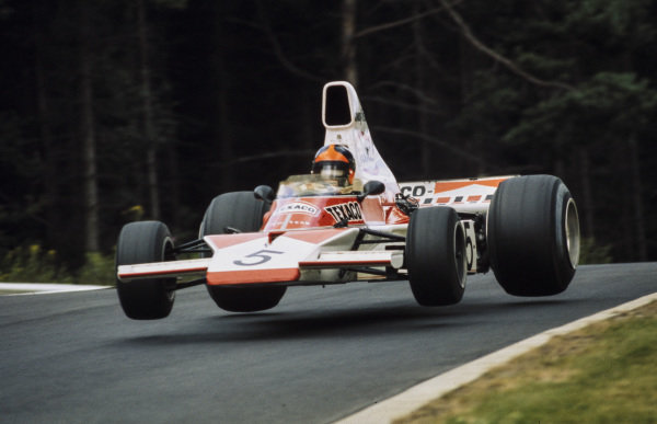 Emerson Fittipaldi, McLaren M23 Ford with all four wheels off the track.