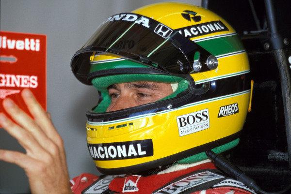 Ayrton Senna consults a monitor.