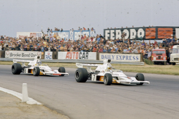Denny Hulme, McLaren M23 Ford leads Peter Revson, McLaren M23 Ford.