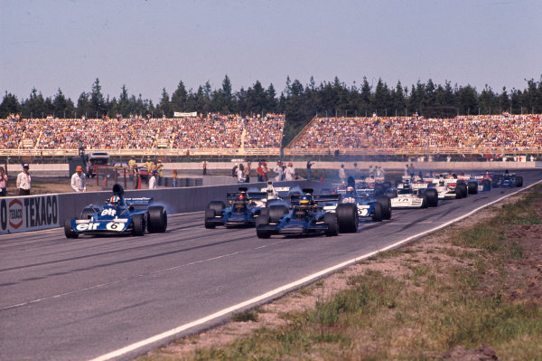 1973 Swedish Grand Prix.Anderstorp, Sweden. 15-17 June 1973.Ronnie Peterson (Lotus 72E Ford), Francoise Cevert (Tyrrell 006 Ford), Emerson Fittipaldi (Lotus 72E Ford) and Jackie Stewart (Tyrrell 006 Ford) lead the field away at the start. Ref-73 SWE 03.World Copyright - LAT Photographic