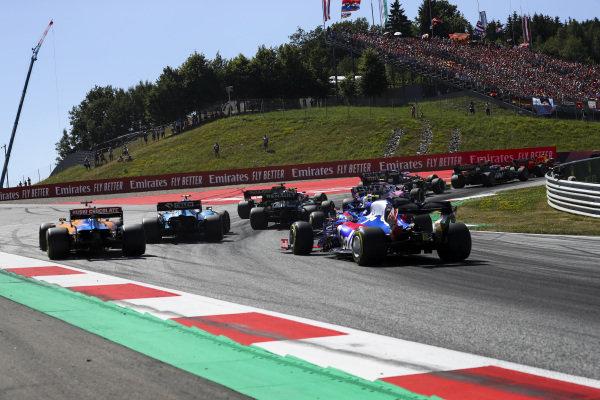 Robert Kubica, Williams FW42, leads Carlos Sainz Jr., McLaren MCL34, and Alexander Albon, Toro Rosso STR14, at the start