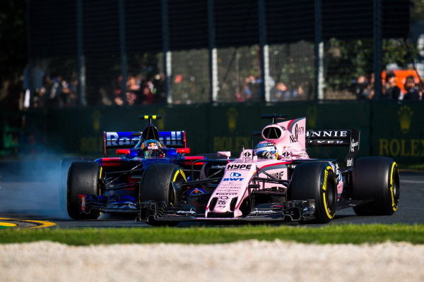 Sergio Perez (MEX) Force India VJM10 and Carlos Sainz jr (ESP) Scuderia Toro Rosso STR12 battle at Formula One World Championship, Rd1, Australian Grand Prix, Race, Albert Park, Melbourne, Australia, Sunday 26 March 2017.