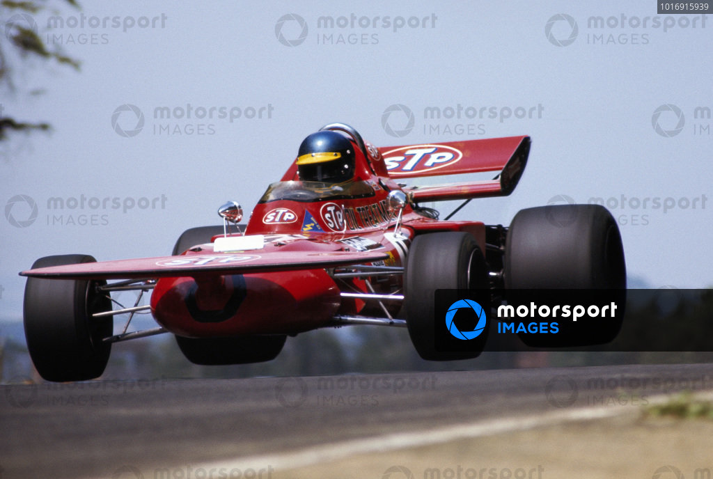 Ronnie Peterson, March 711 Ford, gets airborne over a crest.
