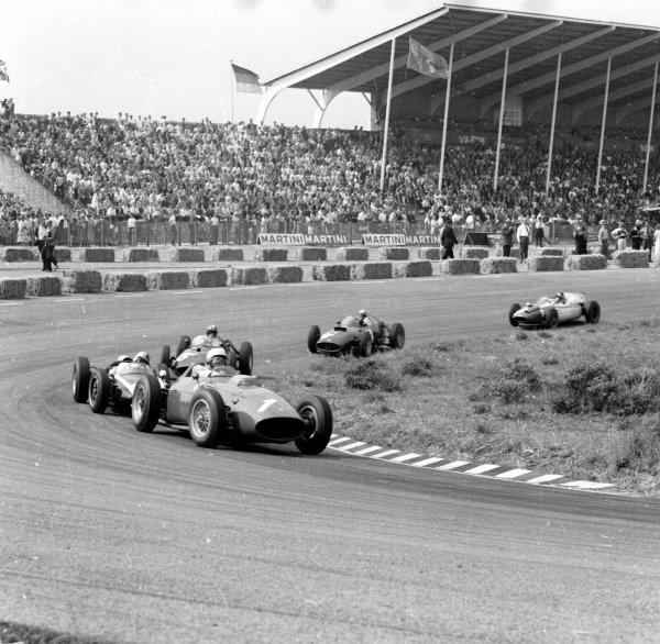1960 Dutch Grand Prix.Zandvoort, Holland.4-6 June 1960.Phil Hill (Ferrari Dino 246) leads Jack Brabham (Cooper T53-Climax), Dan Gurney and Jo Bonnier (both BRM P48) after the start.Ref-6577.World Copyright - LAT Photographic