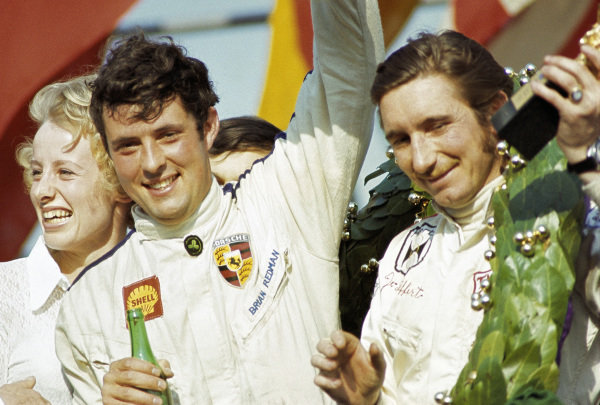 Jo Siffert and Brian Redman, 1st position, celebrate on the podium.