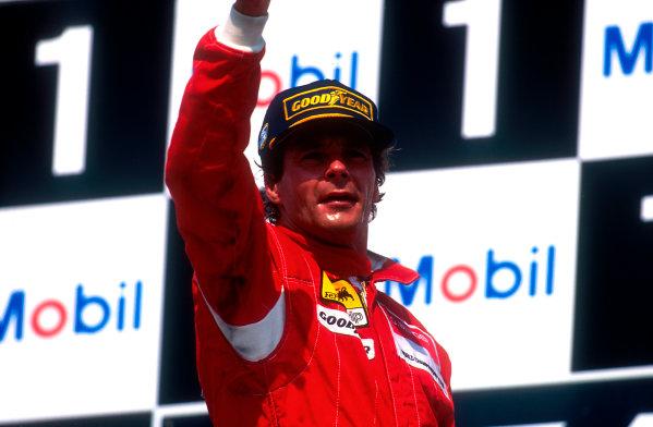 1994 German Grand Prix.Hockenheim, Germany.29-31 July 1994.Gerhard Berger (Ferrari) celebrates 1st position on the podium.Ref-94 GER 11.World Copyright - LAT Photographic