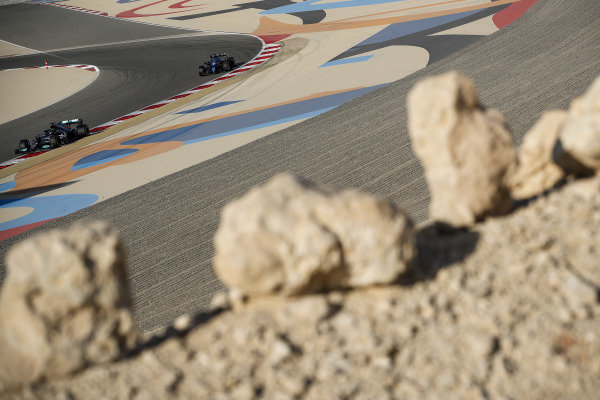 Lewis Hamilton, Mercedes W12 and Fernando Alonso, Alpine A521