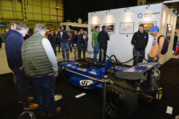 Visitors admire a 1970 March on the Motorsport Images stand.