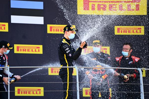 Christian Lundgaard (DNK, ART GRAND PRIX), 1st position, sprays champagne on the podium