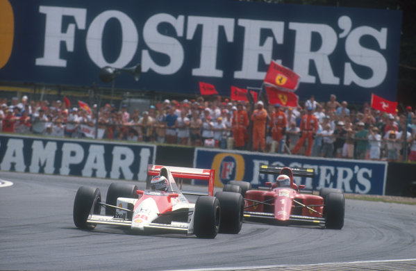 1990 British Grand Prix.Silverstone, England.13-15 July 1990.Gerhard Berger (McLaren MP4/5B Honda) with Alain Prost (Ferrari 641) close behind. Berger exited the race when his throttle control linkage broke, but was classified 14th, Prost finished in 1st position. Ref-90 GB 28.World Copyright - LAT Photographic