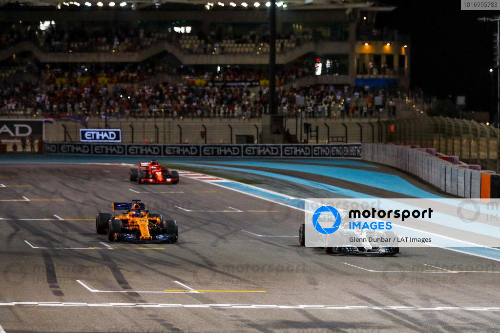 Lewis Hamilton, Mercedes AMG F1 W09 EQ Power+, Fernando Alonso, McLaren MCL33, and Sebastian Vettel, Ferrari SF71H, arrive on the grid after completing a celebration lap