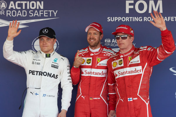 Sochi Autodrom, Sochi, Russia. Saturday 29 April 2017. Top three qualifiers Sebastian Vettel, Ferrari, Kimi Raikkonen, Ferrari, and Valtteri Bottas, Mercedes AMG. World Copyright: Steve Etherington/LAT Images ref: Digital Image SNE18208