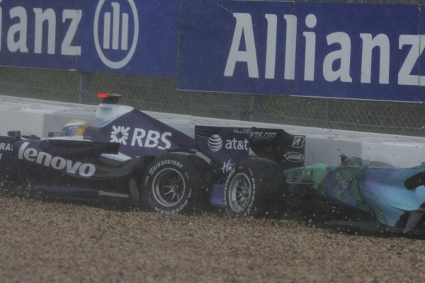2007 European Grand Prix - Sunday RaceNurburgring, Germany.22nd July 2007.Nico Rosberg, Williams FW29 Toyota, retired, slides into the barrier in the same place as Jenson Button, Honda RA107, retired. Action. Crashes. World Copyright: Charles Coates/LAT Photographicref: Digital Image MB5C6007