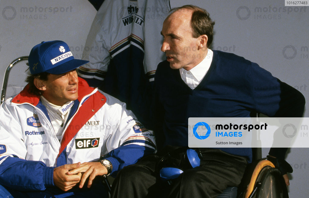 (L to R): Ayrton Senna (BRA) with his new Team Manager Frank Williams (GBR). Formula One Testing, Estoril, Portugal, 18-20 January 1994.