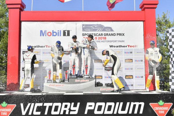 #67 Chip Ganassi Racing Ford GT, GTLM: Ryan Briscoe, Richard Westbrook celebrates the win on the podium with #3 Corvette Racing Chevrolet Corvette C7.R, GTLM: Antonio Garcia, Jan Magnussen, #4 Corvette Racing Chevrolet Corvette C7.R, GTLM: Oliver Gavin, Tommy Milner,