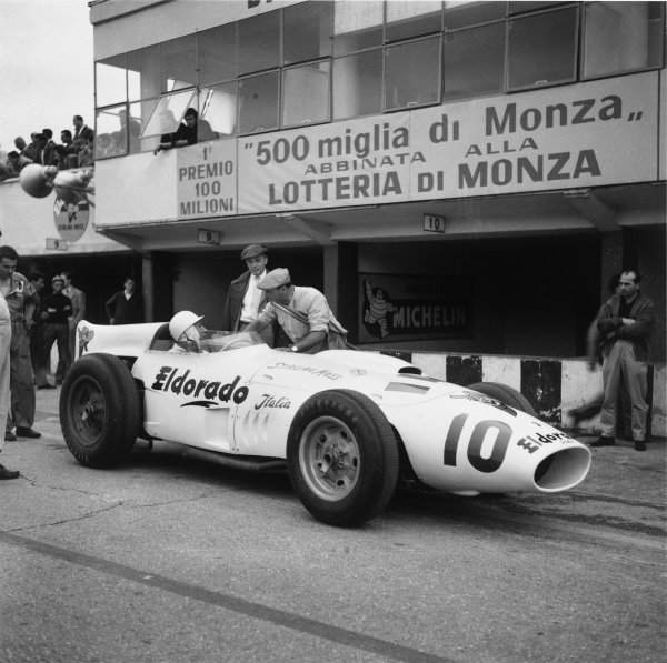 Monza, Italy. 29th June 1958.Stirling Moss (Eldorado Maserati Special),4th in heat 1, 5th in heat 2 and retired in heat 3. The race was also known as Monzanapolis, pit lane action.World Copyright: LAT Photographic.Ref: 1043.