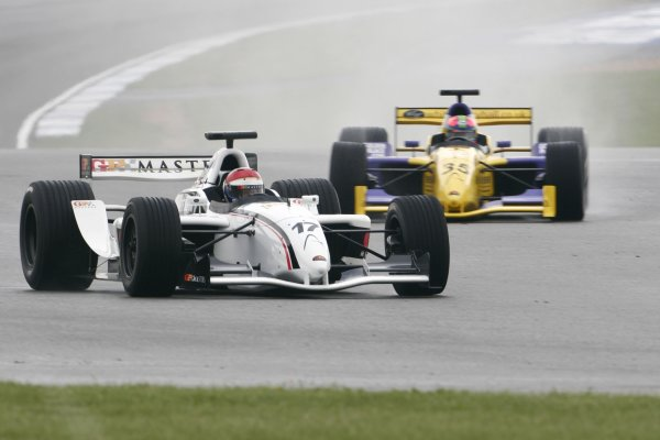 2006 Grand Prix Masters.Silverstone, England. 11th - 13th August.Eddie Cheever battles for the lead with Eric Van De Poele. ActionWorld Copyright: Drew Gibson/LAT Photographic.Ref: Digital Image Only.