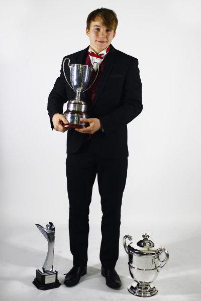 2013 Autosport Awards. Grosvenor House Hotel, Park Lane, London. Sunday 1st December 2013. McLaren Autosport BRDC Award winner Matt Parry with his trophies. World Copyright: Malcolm Griffiths/LAT Photographic. ref: Digital Image F80P2194