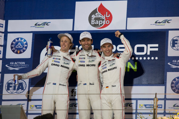 2015 WEC Bahrain International Circuit, Bahrain Saturday 21 November 2015. Mark Webber, Timo Bernhard and Brendon Hartley (#17 Porsche 919 Hybrid) celebrate on the podium after winning the drivers' championship. Photo: Sam Bloxham/LAT ref: Digital Image _SBL5894