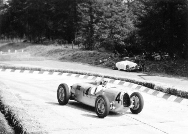 1936 Italian Grand Prix Monza, Italy. 13 September 1936 Bernd Rosemeyer, Auto Union C, 1st position, passes the retired car of team-mate Hans Stuck, action World Copyright: Robert Fellowes/LAT PhotographicRef: 36ITA12