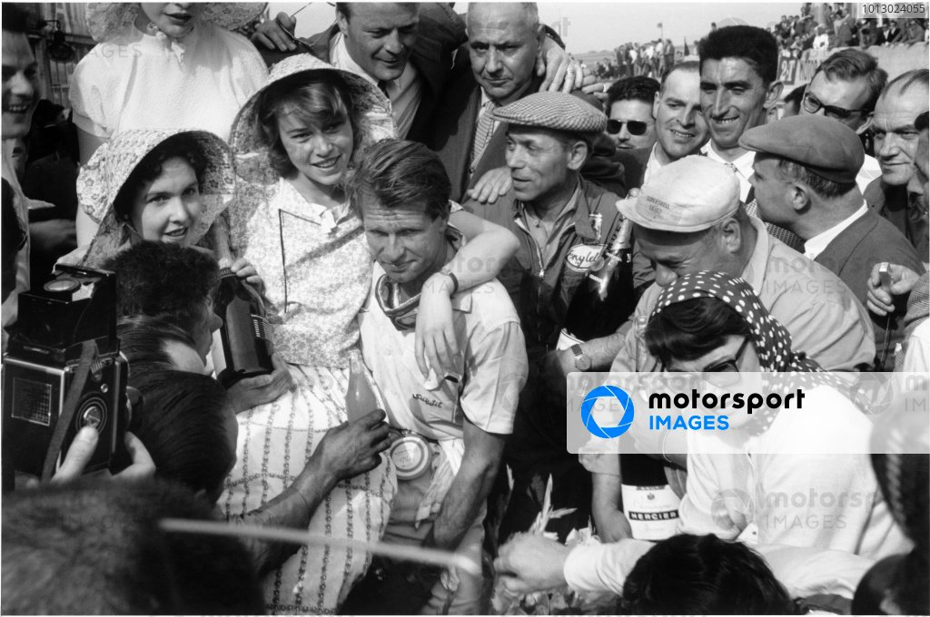 1956 French Grand Prix.Reims-Gueux, France. 1 July 1956.Peter Collins (Lancia-Ferrari) enjoys the spoils of victory, 1st position.World Copyright: LAT PhotographicRef: black & white exhibition A022/MotorSport calendar