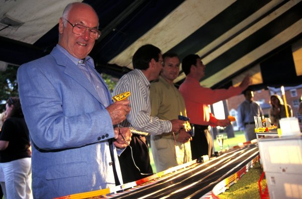 ITV Formula One commentator Murray Walker (GBR), pundit Simon Taylor (GBR), Presenter Jim Rosenthal (GBR) and Pit Reporter James Allen (GBR) play with a scalextric.