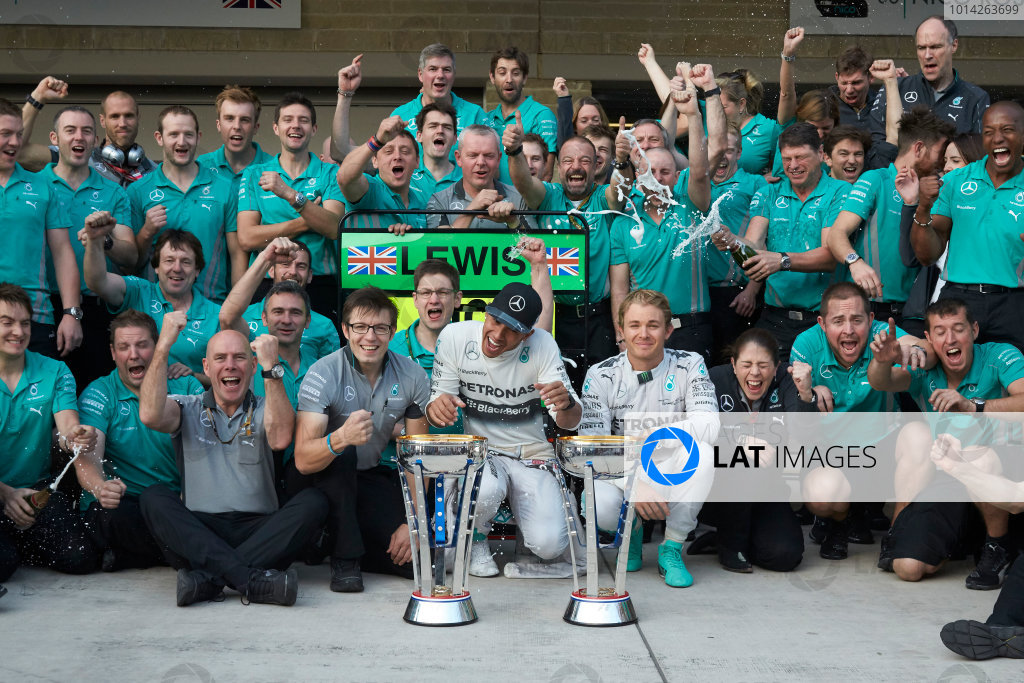 Circuit of the Americas, Austin, Texas, United States of America. Sunday 2 November 2014. Lewis Hamilton, Mercedes AMG celebrates with the team and Nico Rosberg, Mercedes AMG after winning the race. World Copyright: Steve Etherington/LAT Photographic. ref: Digital Image SNE25053