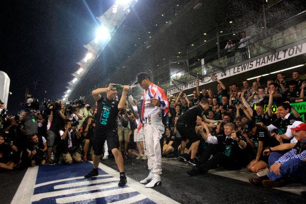Yas Marina Circuit, Abu Dhabi, United Arab Emirates. Sunday 23 November 2014. Lewis Hamilton, Mercedes AMG, 1st Position, celebrates 2014 Championship victory with his team. World Copyright: Andrew Ferraro/LAT Photographic. ref: Digital Image _MG_1558