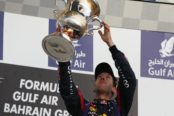 Bahrain International Circuit, Sakhir, Bahrain Sunday 21st April 2013 Sebastian Vettel, Red Bull Racing, 1st position, lifts his trophy. World Copyright: Andy Hone/LAT Photographic ref: Digital Image HONZ3015