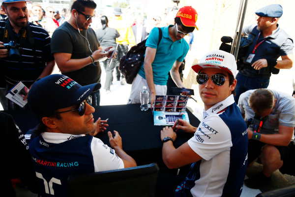 Circuit Gilles Villeneuve, Montreal, Canada. Thursday 08 June 2017. Lance Stroll, Williams Martini Racing, and Felipe Massa, Williams Martini Racing, sign autographs for fans. World Copyright: Andy Hone/LAT Images ref: Digital Image _ONZ9887