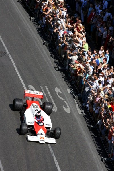 Gerhard Berger (AUT) Scuderia Toro Rosso Team Part Owner in a McLaren MP4/1C drives through the streets of Budapest.