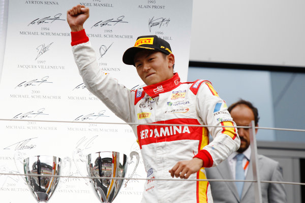 2015 GP2 Series Round 4.  Red Bull Ring, Spielberg, Austria.  Sunday 21 June 2015. Rio Haryanto (INA, Campos Racing) celebrates his win on the podium.