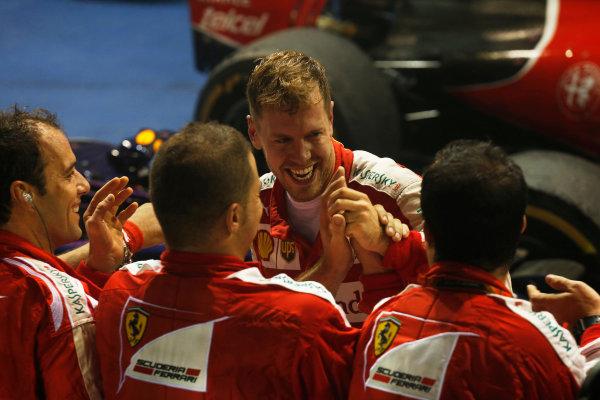 Marina Bay Circuit, Singapore. Sunday 20 September 2015. Sebastian Vettel, Ferrari, 1st Position, celebrates with his team in Parc Ferme. World Copyright: Alastair Staley/LAT Photographic ref: Digital Image _79P4022