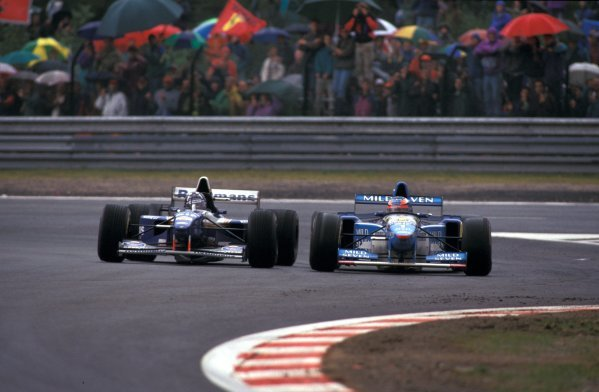 Race winner Michael Schumacher (GER) Benetton B195 (right) and second place finisher Damon Hill (GBR) Williams FW17 battle for the lead in a robust fashion. Formula One World Championship, Belgian Grand Prix, Spa-Francorchamps, 27 August 1995 Catalogue Ref.: 10-200 Sutton Motorsport Images Catalogue