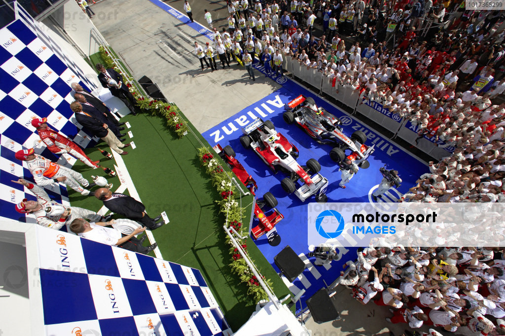 The teams gather for the podium ceremony as Timo Glock, 2nd position, celebrates his first podium finish.