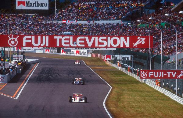 1993 Japanese Grand Prix.Suzuka, Japan.22-24 October 1993.Ayrton Senna (McLaren MP4/8 Ford) leads Alain Prost (Williams FW15C Renault) and Mika Hakkinen (McLaren MP4/8 Ford).Ref-93 JAP 12.World Copyright - LAT Photographic