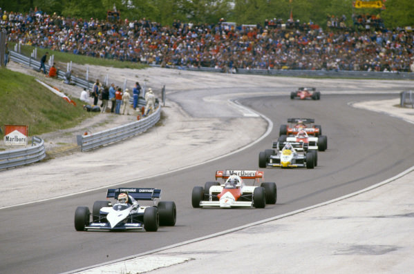 Nelson Piquet, Brabham BT53 BMW, leads Alain Prost, McLaren MP4-2 TAG, Keke Rosberg, Williams FW09 Honda, Niki Lauda, McLaren MP4-2 TAG, Michele Alboreto, Ferrari 126C4, and René Arnoux, Ferrari 126C4.