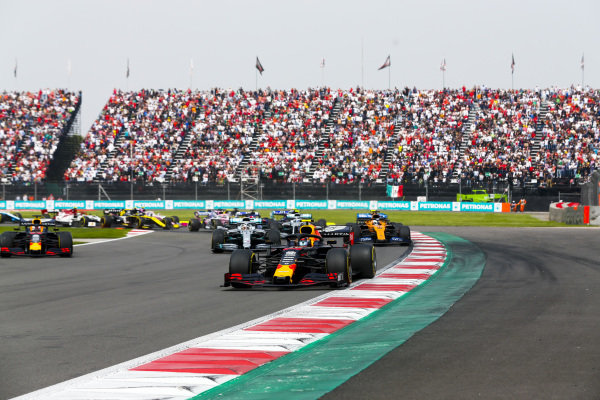 Alexander Albon, Red Bull RB15, leads Max Verstappen, Red Bull Racing RB15, Lewis Hamilton, Mercedes AMG F1 W10, Valtteri Bottas, Mercedes AMG W10, Carlos Sainz Jr., McLaren MCL34, and the remainder of the field at the start