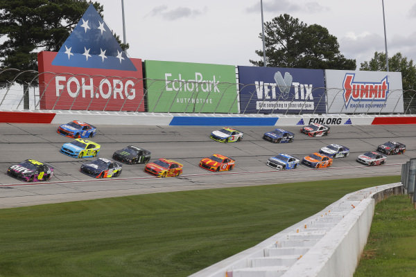 Jimmie Johnson, Hendrick Motorsports Chevrolet Ally, leads a pack of cars, Copyright: Chris Graythen/Getty Images.