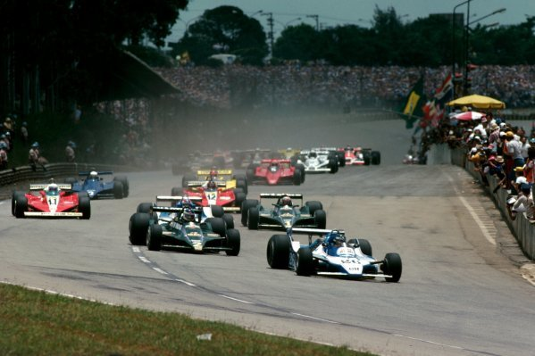 Race winner Jacques Laffite (FRA) Ligier JS11 leads third placed Carlos Reutemann (ARG) Lotus 79 into the first corner at the start of the race. Brazilian Grand Prix, Rd 2, Interlagos, Brazil, 4 February 1979. BEST IMAGE