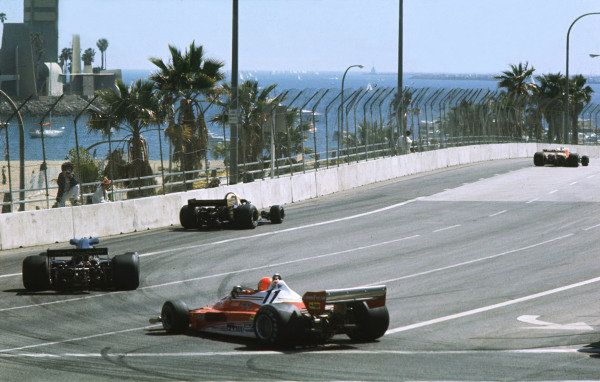 1977 United States Grand Prix West. Long Beach, California, USA. 1-3 April 1977. Jody Scheckter (Wolf WR1 Ford) leads Mario Andretti (Lotus 78 Ford) and Niki Lauda (Ferrari 312T2) out of Le Gasomet into Shorline Drive. World Copyright - LAT Photographic  Ref: 77LB12