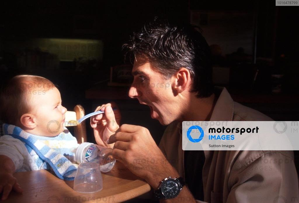 Damon Hill (GBR) feeds his young daughter Rosy at his home in Ireland.Home Feature, Dublin, Eire, 12 October 1998.