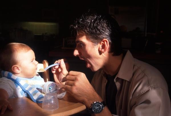 Damon Hill (GBR) feeds his young daughter Rosy at his home in Ireland.