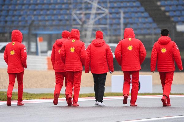 Sebastian Vettel, Ferrari walks the track with members of his team