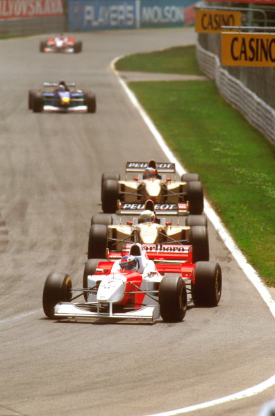 Montreal, Quebec, Canada.14-16 June 1996.Mika Hakkinen (McLaren MP4/11 Mercedes) leads the two (Jordan 196 Peugeot)s of Martin Brundle and Rubens Barrichello, respectively.Ref-96 CAN 02.World Copyright - LAT Photographic