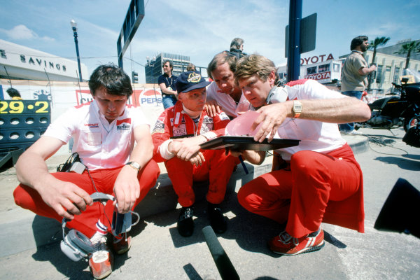 Long Beach, California, USA. 2 - 4 April 1982.Niki Lauda (McLaren Ford) 1st position, in converstation with Ron Dennis, Tyler Alexander and sitting, John Barnard, portrait. World Copyright: LAT Photographic.Ref:  Colour Transparency.