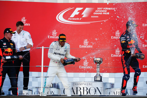 Suzuka Circuit, Japan. Sunday 8 October 2017. Max Verstappen, Red Bull, 2nd Position, Lewis Hamilton, Mercedes AMG, 1st Position, and Daniel Ricciardo, Red Bull Racing, 3rd Position, celebrate with Champagne on the podium. World Copyright: Andrew Hone/LAT Images  ref: Digital Image _ONY8799