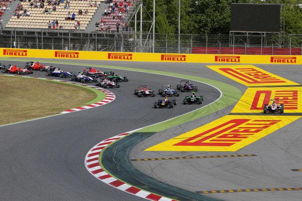 Race 1 winner Alex Lynn (GBR) Carlin leads at the start. GP3 Series, Rd1, Barcelona, Spain, 9-11 May 2014.