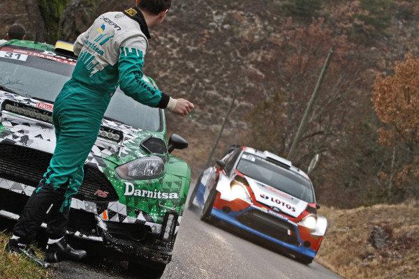 Co-driver Pavel Cherepin (UKR) Ford Focus WRC, watches Robert Kubica (POL) / Maciek Szczepaniak (POL), Ford Fiesta RS WRC pass. FIA World Rally Championship, Rd1, Rally Monte Carlo, Day One, Monte Carlo, 16 January 2014.