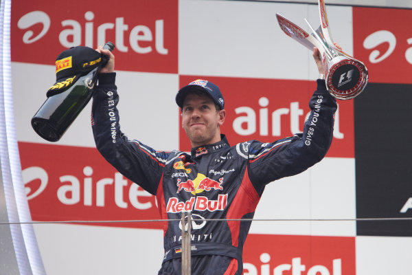2012 Indian Grand Prix - Sunday Buddh International Circuit, New Delhi, India. 28th October 2012. Sebastian Vettel, Red Bull Racing, 1st position, with his trophy and Champagne. World Copyright:Steve Etherington/LAT Photographic ref: Digital Image SNE19905 copy